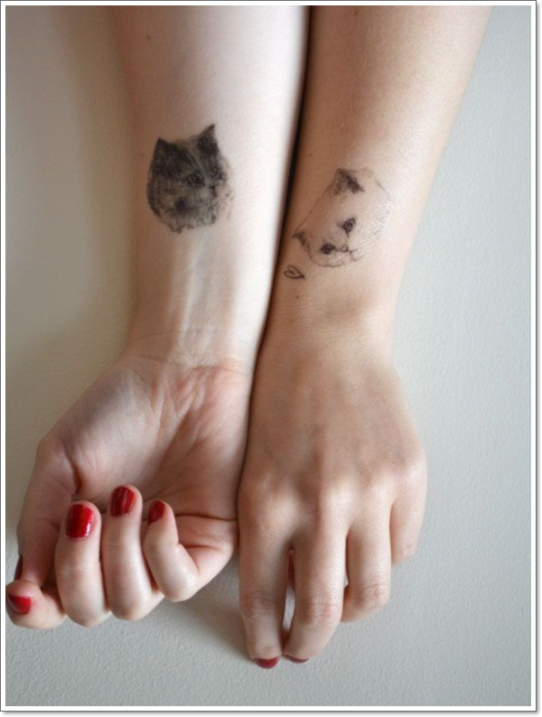 cat tattoo on both hands