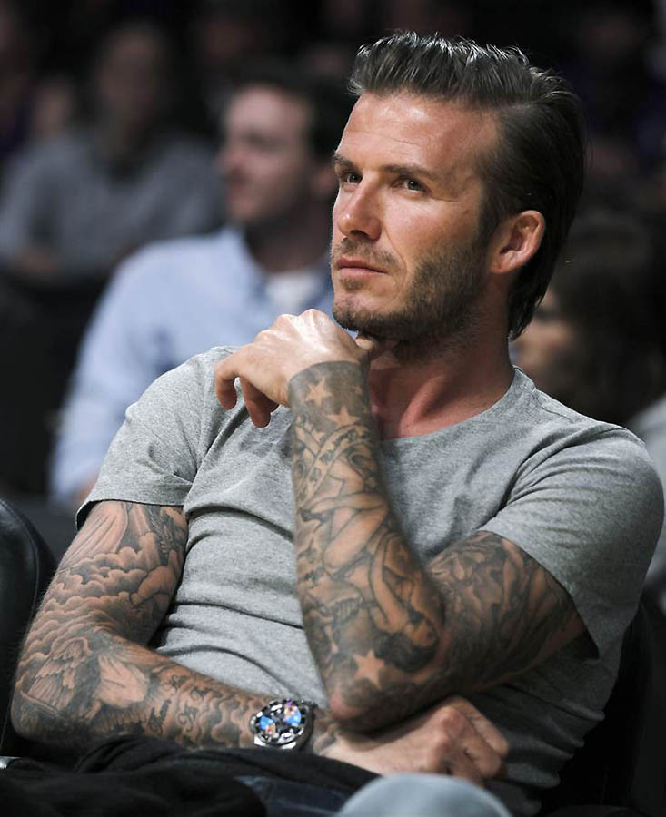 35 well renowned tattoos on celebrities for David beckham tattoo sleeve